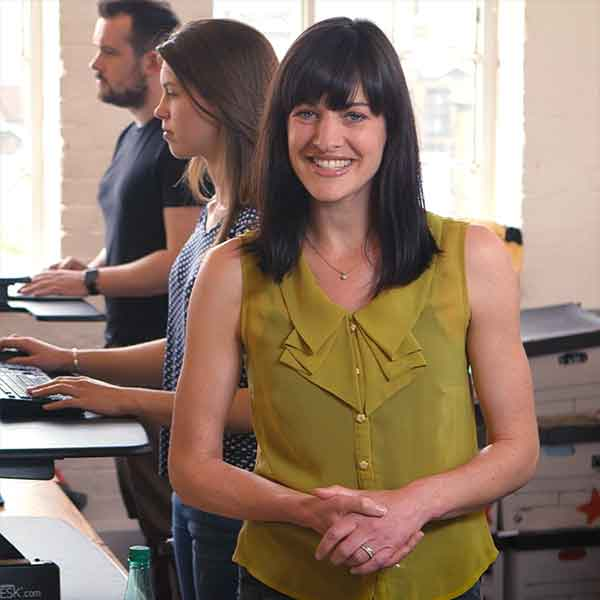 Presenter Loren Peta introduces Varidesk's height-adjustable standing desks