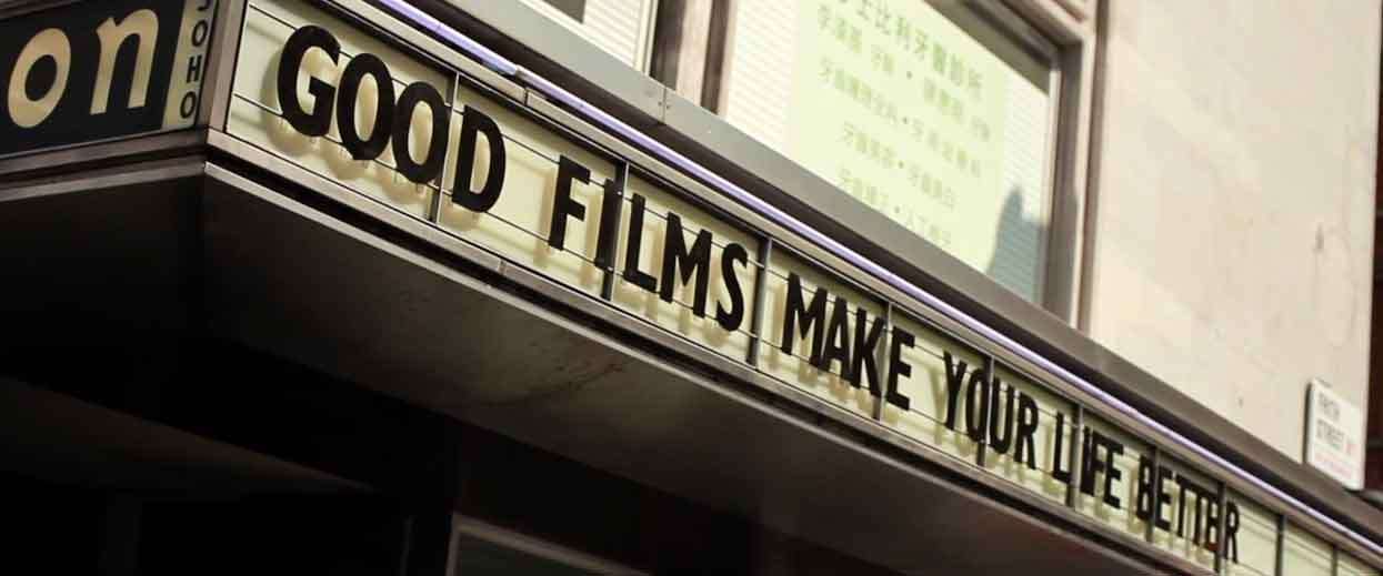 A sign on the Curzon Soho cinema that reads 'Good films makes your life better'. Links to a voc pop video of Londoners talking about the importance of video.